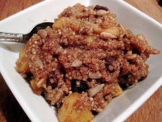 2 cups water 1/2 cup quinoa 1 large apple, peeled and chopped into bite size pieces 1 ounce walnuts 1/4 cup sunflower seeds 1/4 cup raisins 2 tsp cinnamon 1/4 tsp allspice 2 Tbsp maple syrup Put qu...