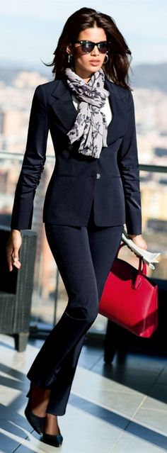 Navy pantsuit with pattern scarf & red bag