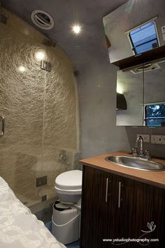 Airstream - Paperstone counter top, Marmoleum flooring and Lumicor shower panel