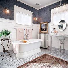 Gun-metal Venetian plaster walls heighten the period detail of this Victorian-style bath. | Photo: Karen Melvin | thisoldhouse.com