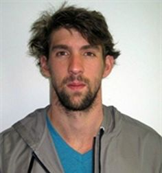 Michael Phelps says he just woke up from a nap before taking hilarious head shot picture -