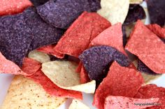 """red corn, white corn & blue corn tortilla chips!  Perfect to go with the flag 7 layer dip!  I'm thinking also make some (artificially dyed) red, """"white"""" and blue hummus (for the veeegans)"""