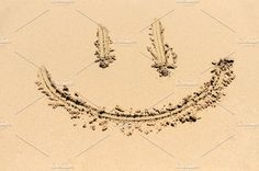 A smiley face drawn in the sand Photos A smiley face drawing on a sand by byrdyak