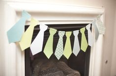 Little tie hanging decoration over fireplace baby shower boy