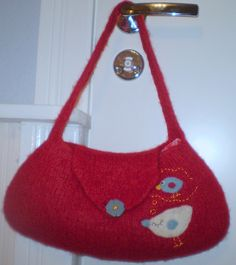 Red felted bag with a white birdie