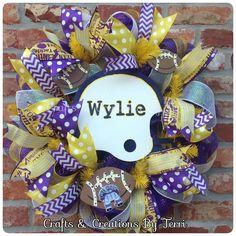 High school helmet football wreath. More wreaths can be found on my Facebook page: www.facebook.com/CraftsandCreationsByTerri or go to my Etsy page https://www.etsy.com/shop/CreatedByTerri