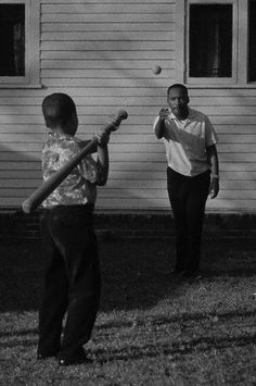 Martin Luther King Jr. throws a baseball to his son Marty in their backyard on Nov 8, 1964 in Atlanta.
