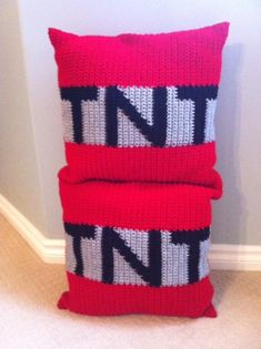 Mine Craft inspired TNT pillows.  Crochet graph is sewn onto one side of the pillow.