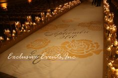 Hand painted aisle runner, lined with candles | Exclusive Events, Inc.