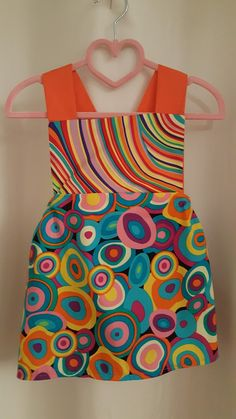 I Love creating my own designs. This is the front of my Pinafore Dress, for little girls
