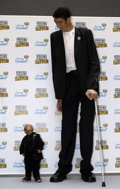 In this Jan. 14, 2010 file photo, Sultan Kosen of Turkey, 27, right, and He Pingping of China, 21, seen, during an event organized by the Guinness World Records in Istanbul, Turkey. When the image was taken, the towering Turk, Kosen, is the tallest man walking the planet with a height of 246.5 cm ( 8 feet 1 inch) and He is officially the world's shortest man with a height of 73 cm (2 feet 5 inch).
