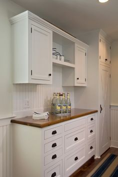 White country cabinets with brown granite or butcher block wood countertops, my fave kitchen look