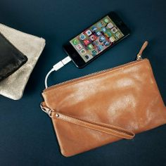 This purse has an iPhone charger built in! http://thestir.cafemom.com/technology/163786/5_cool_gadgets_that_make?utm_medium=sm&utm_source=pinterest&utm_content=thestir