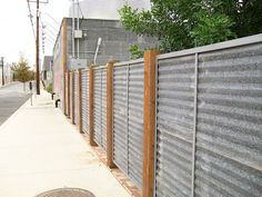 Metal Tin privacy fencing...Very different but I like it