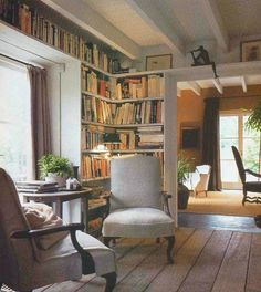 Library / reading corner that's bright and cosy. Perfect with a window seat or chaise longue