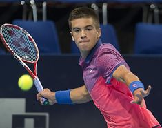 Croatia's Borna Coric returns a ball to Kazakhstan's Andrey Golubev during their match at the Swiss Indoors tennis tournament at the St. Jakobshalle in Basel, Switzerland, Oct. 23, 2014