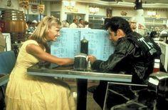 John Travolta and Olivia Newton-John as Danny and Sandy (Grease,1972)