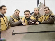 C: A group of pilots of No. 303 Polish Fighter Squadron RAF stand by the tail elevator of one of their Hawker Hurricane Mk.Is at Northolt in Middlesex, England. Early October 1940 They are (left to right): Pilot Officer Mirosław Ferić, Flying Officers Bogdan Grzeszczak, Pilot Officer Jan Zumbach, Flying Officer Zdzisław Henneberg and Flight-Lieutenant John Kent, who commanded 'A' Flight of the Squadron at this time.