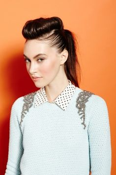 Trying to figure out if I can rock this bouffant roll faux-undercut ponytail.  The 'Hawk Hybrid via Refinery29.