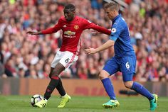 Paul Pogba of Manchester United and Roberth Huth of Leicester City during the Premier League match between Manchester United and Leicester City at...