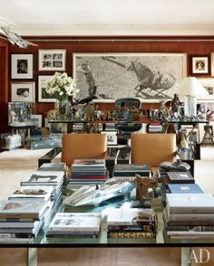 Ralph Lauren's office at the company's Madison Avenue headquarters is filled with art, books, and sundry objects that inspire him, including a 1950s model plane suspended from the ceiling. A large graphite drawing by Woodrow Blagg is displayed behind the designer's Highbridge glass-top desk, which is by Ralph Lauren Home. The City Modern cocktail table and leather-clad RL-CF1 Carbon Fiber lounge chairs are Ralph Lauren Home designs as well.