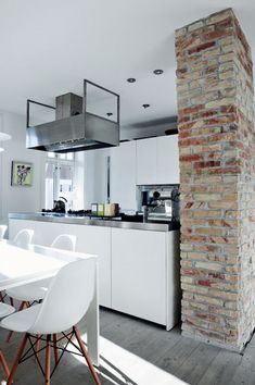 I love white in kitchens!... maybe not my kitchen though... never thought brick would look so good here too
