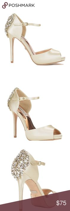 BADGLEY MISCHKA - Dawn' Crystal Back d'Orsay Pump BADGLEY MISCHKA - Dawn' Crystal Back d'Orsay Pump (USED) SZ 7.5 - Still have box, shoe cloths, additional jewels if wanted/needed. Worn once on wedding day, shoes absolutely need to be steamed, shows signs of minor grass stains from ceremony etc. By far the most comfortable and supportive wedding shoe, no need to change. Beautiful bought from Nordstrom May 2017 for $275.00 Color Ivory Badgley Mischka Shoes Heels