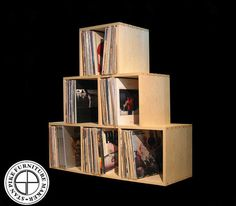 Record Album Storage Pyramid by stanpike on Etsy. Good looking. Holds 480 records for $500. Or buy individual crate that holds 80 for $99.