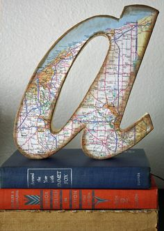 DIY Map covered letters. Would be cool to cover with maps of meaningful places. Could do each child's name and a map of the state with the city they were born in for each kid!