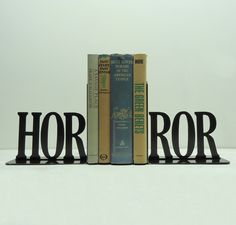 I love these! These artists are genius!! Horror Metal Art Bookends Free USA Shipping by KnobCreekMetalArts, $59.99