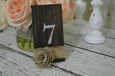 Table numbers by RedHeartCreations on Etsy, $34.93....I could easily make these for cheap!