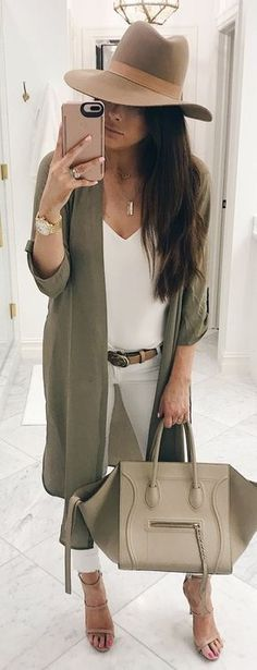 Olive cardigan over winter white.