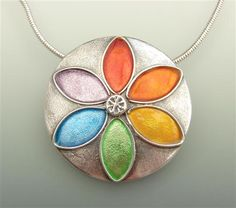 """Rainbow Star  A handmade fine silver pendant with a rainbow of enamelled colours. Measures approx 34mm on a 16"""" sterling silver chain."""