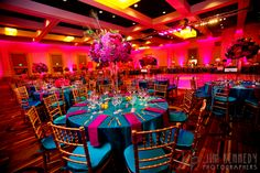 Create a reception atmosphere that truly embraces the richness of a peacocks colors.    Orange County Indian Wedding by Jim Kennedy Photographers | MaharaniWeddings.com