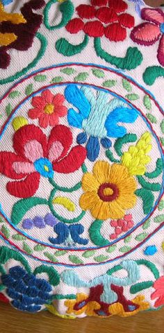 folklore embroidered pillow