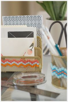 Sweet! Bring a touch of crafty organization to your workspace -- by cross-stitching on standard steel mesh office supplies!  Click through to see how.