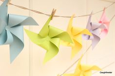 pretty pinwheel bunting hung with tiny clothespins (I know I saw some in Walmart's craft section)