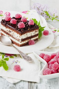 festive table. cake with raspberry jelly candies and lilac flowers.selective focus