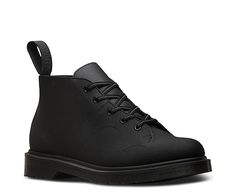 The look is unmistakable, with low-on-the-toe laces, a slender shape and oval stitching. The first Dr. Martens Church Monkey boots were originally just for kids, using leftover leather from a local factory. The initial production was limited, but it enjoyed surprise popularity among '70s British youth culture—and soon became a staple men's boot. This version is made for after dark, in reflective Glassine. At first glance, it's allover black—but at nighttime, it becomes reflective, in sharp…