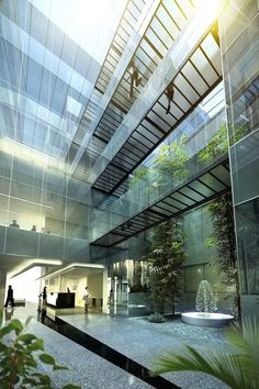 """I imagined a larger atrium space than this, but with interior plants and sunlight as seen here. The canteen would be at the ground level, and also used of """"all hands"""" meetings where Mina could address the company from a balcony"""