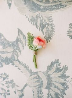 Sweet boutonniere in simple coral pink