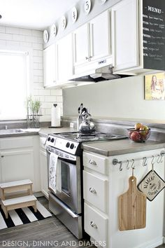 I love the cabinets and color of this kitchen. It might be cool to add a splash of color somewhere though.