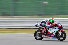Panning image of World Superbike race - ISO-100, f/13, 1/80 sec.