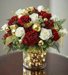 Flower Vase and Christmas Gold Ornaments with White Roses or Red or Both I would use, Greeny.