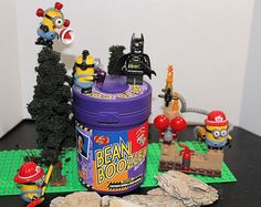 WeeO! WeeO! WeeO! Well we found someone to try out the #beanboozled with the help of some #minions we got The #batman one brave soul indeed dont know if I would trust them #minions #megabloks #lego #jellybelly
