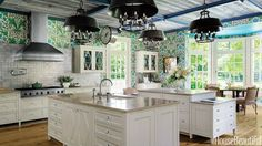 In an English Lutyens-inspired kitchen in Long Island, designer Stephen Sills found two antique light fixtures by Gilbert Poillerat and had two more made.