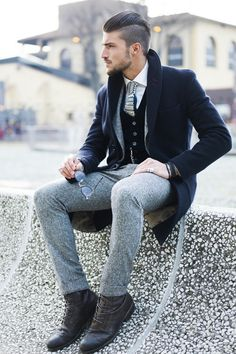 Mariano Di Vaio, wearing a Black Wool 3/4 Jacket, and Grey Tweeded Flannel Pants. Men's Fall Winter Fashion @ Pitti Uomo.
