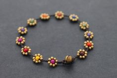♥100 % HAND WOVEN IN THAILAND This is hand woven anklet made with dark brown cotton waxed cord weaved together with brass beads and a mixture of difference stone . Closure using brass bell ♥ Anklet measures 10 inch long ♥♥You can see similar items by clicking this link♥♥
