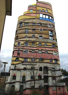 "The Austria artist and architect Friedensreich Hundertwasser is said to have once called straight lines ""the devil's tools."" Hundertwasser d. Unusual Buildings, Interesting Buildings, Amazing Buildings, Architecture Design, Beautiful Architecture, Creative Architecture, Architecture Portfolio, Classical Architecture, Futuristic Architecture"