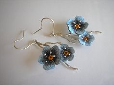 Earrings on a stick made from silver 930 and natural leather. Flowers forget-painted by hand waterproof and abrasion-resistant paint in shades of blue, finished with decorative veins. Silver frosted.
